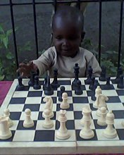 John Chibvuri Jnr (7) scoops his first major Gold Medal in a Primary School Chess Festival